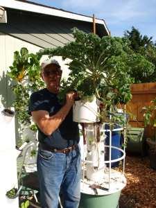 Bob holding the told of the Tower Garden with its giant kyle.