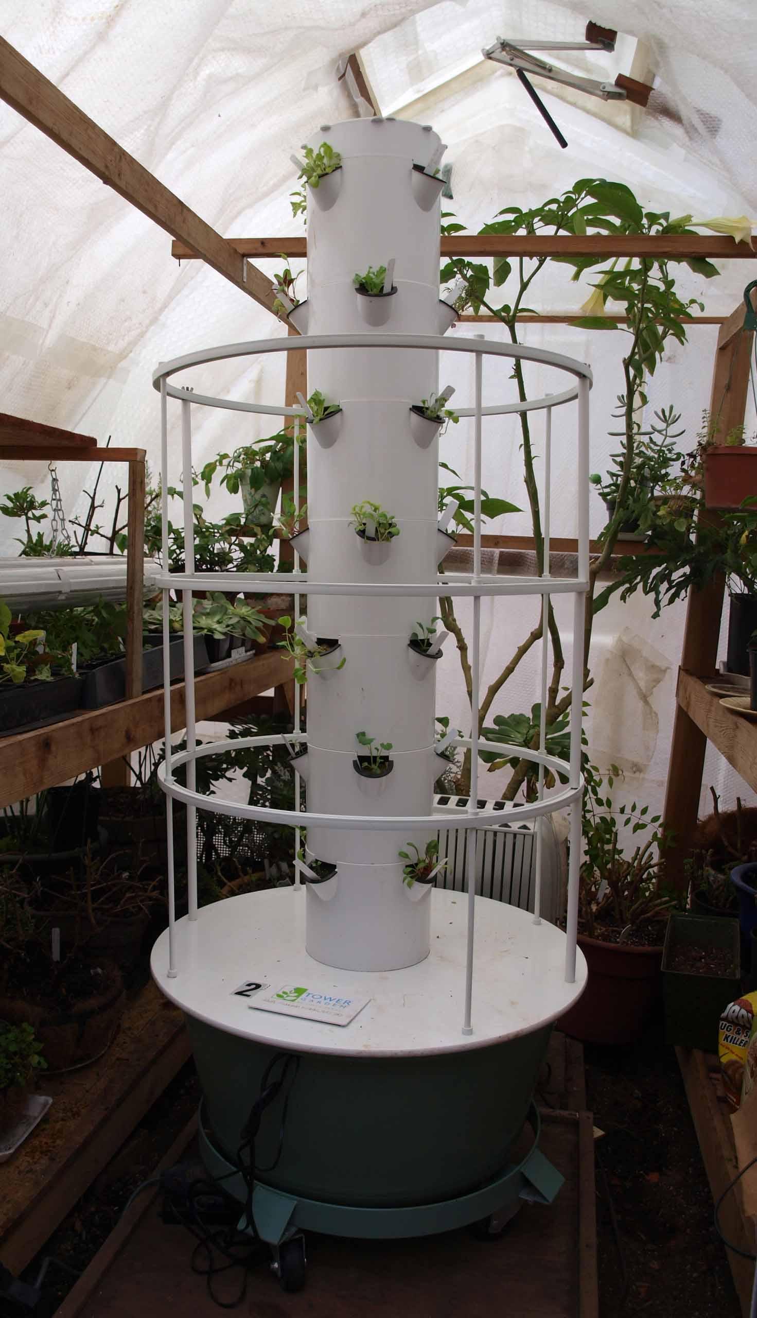 Tower garden t 5 growing lights backyard tower garden for Vertical garden tower