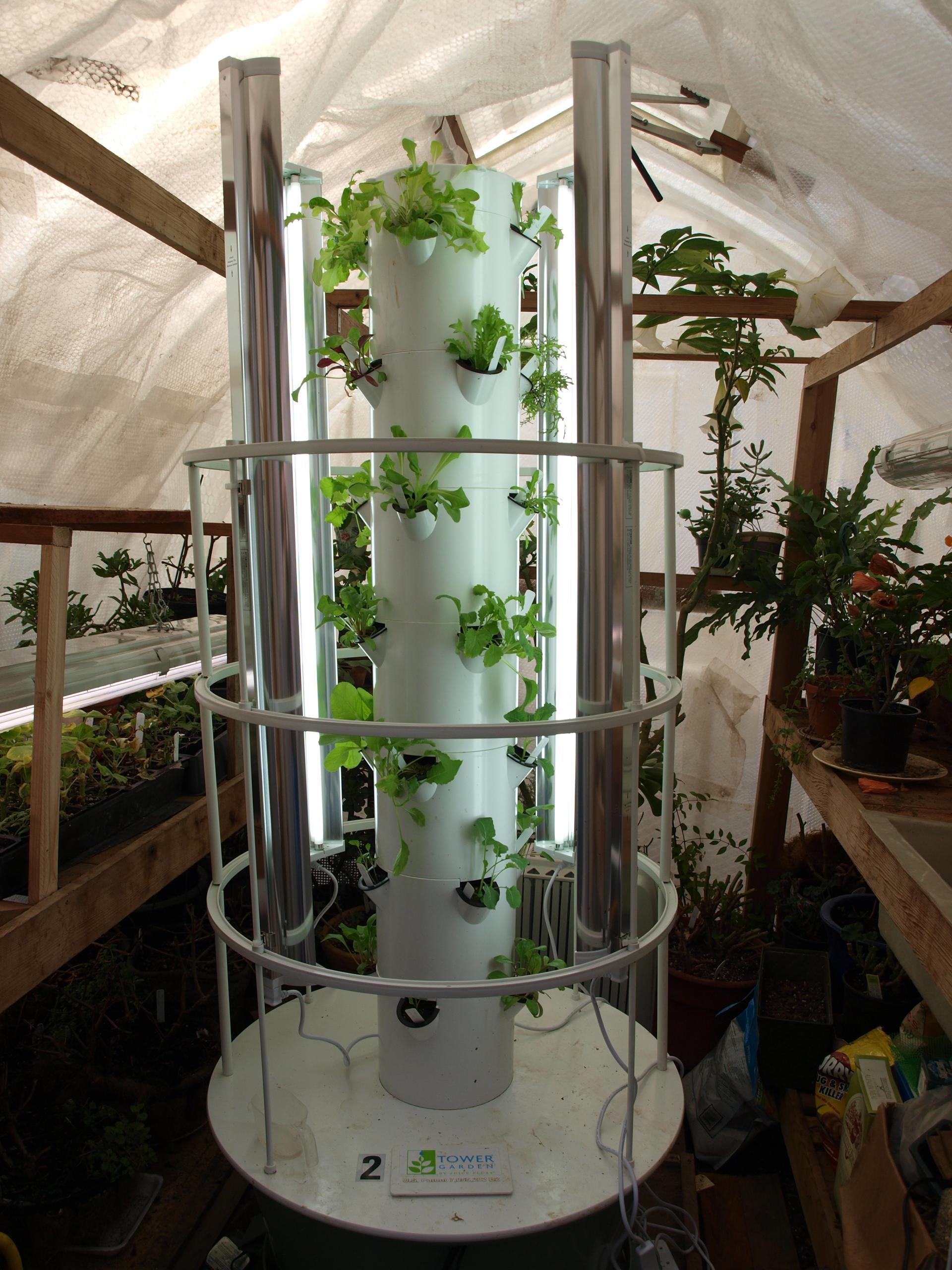 Greenhouse backyard tower garden for Vertical garden tower